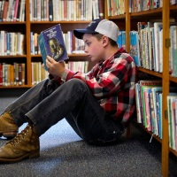 Snapshot: Boy Reading At The Library