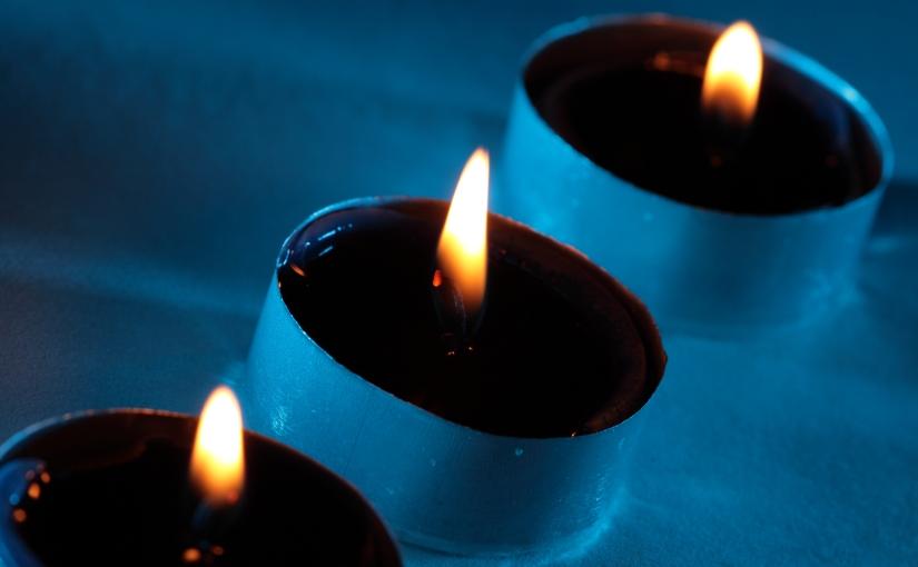 three blue candles
