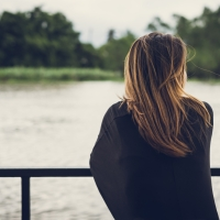 Snapshot: Young Woman By The River
